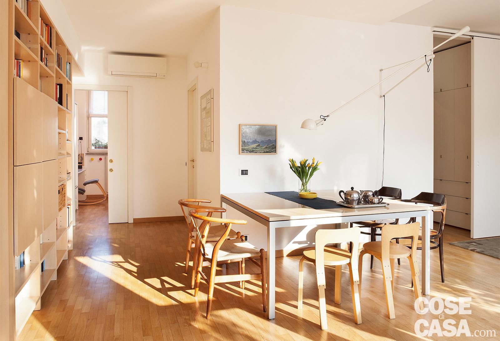 Come Dividere Sala E Cucina libreria e tavolo da pranzo