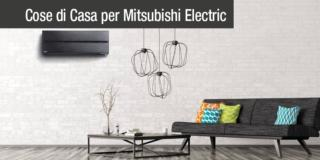 Climatizzatore split Mitsubishi Electric Kirigamine - Interior of living room with black sofa, coffee table, lamps over brick wall 3d rendering
