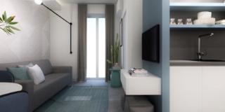 soggiorno con divano e parete azzurra con tv